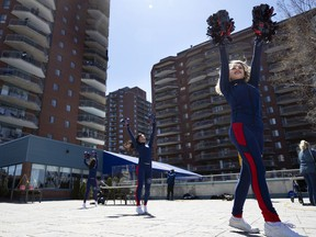 The Alouettes' cheerleaders perform at Au Fil De L'Eau Residence in Montreal on May 13, 2020.