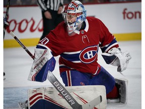 Canadiens goaltender Cayden Primeau watches a rebound as puck goes into the corner after making a save during NHL game against the Ottawa Senators at the Bell Centre in Montreal on Dec. 11, 2019.