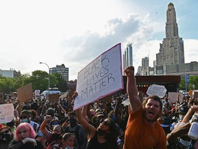 """Protesters gather during a """"Black Lives Matter"""" protest near Barclays Center on Friday, May 29, 2020, in the Brooklyn borough of New York City, in outrage after George Floyd, an unarmed black man, died while being arrested by a police officer in Minneapolis who pinned him to the ground with his knee. Demonstrations are being held across the U.S. after Floyd died in police custody on May 25."""