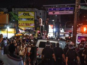 People dance on top of a car during a protest on June 6, 2020 in the Brooklyn borough in New York City. This is the 12th day of protests since George Floyd died in Minneapolis police custody on May 25.