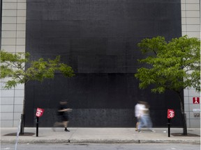 The Apple Store on Ste-Catherine St. appears to make a statement while covering their flagship storefront windows ahead of a planned march against police brutality. The plywood protecting the windows took the shape of a large black square, a symbol used in support of the Black Lives Matter movement in Montreal, on Saturday, June 6, 2020.