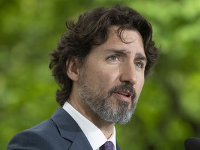 Prime Minister Justin Trudeau responds to a question from a member of the media on site during a daily news conference outside Rideau Cottage in Ottawa, Monday May 25, 2020.