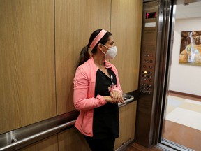 Co-director of the intensive care unit at CommonSpirit's Dignity Health California Hospital Medical Center, Dr. Zafia Anklesaria, 35, who is seven months pregnant, arrives at work to treat patients in the intensive care unit, during the coronavirus disease (COVID-19) outbreak, in Los Angeles, California, U.S., May 18, 2020.  REUTERS/Lucy Nicholson