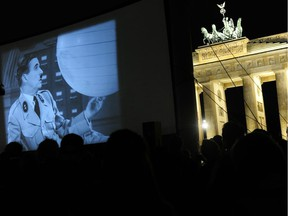 An open-air screening of The Great Dictator in Berlin in 2011. Luckily, writes Joe Schwarcz, modern technology allows us to watch Charlie Chaplin's films without having to go to the theatre — or gather in large groups.