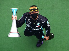 Race winner Lewis Hamilton of Great Britain and Mercedes GP celebrates on the podium after the Formula One Grand Prix of Hungary at Hungaroring on July 19, 2020 in Budapest, Hungary.