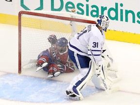 Canadiens' Paul Byron ended up in the Toronto net behind Leafs goalie Frederik Andersen after being hooked during the second period Tuesday night in Toronto.