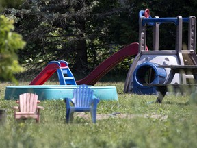 A children's playground sits idle at a home near the scene of a tractor accident that saw three young children die in Notre-Dame-de-Stanbridge.