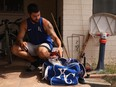 MLB pitcher Jakob Junis with the Royals puts equipment back into a bag after a backyard throwing session in Scottsdale, Ariz., June 5, 2020.