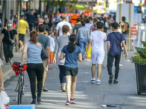 """People walk on the pedestrian zone on St-Catherine St. in Montreal Wednesday August 5, 2020. """"To be sure, COVID-19 has created considerable anxiety and insecurity across Canada,"""" Rob Whitley writes, but for some, """"it may provide a much-needed breathing space and an opportunity to rethink priorities."""""""