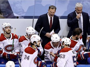 Associate Coach Kirk Muller (top left) of the Montreal Canadiens shouts from the bench against the Philadelphia Flyers during the first period in Game 2 at Scotiabank Arena in Toronto on Aug. 14, 2020.