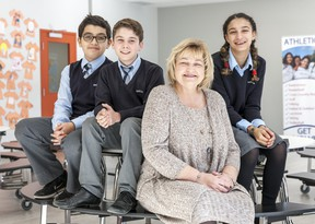 Janice Ewanyshyn, middle school co-ordinator, is shown with a trio of students. Through elementary, middle school, high school and Grade 12, each Kells Academy student is met with a welcoming, supportive and inclusive academic environment.