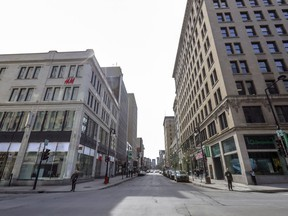 The corner of Peel and Ste-Catherine Sts. is seen in the middle of a weekday in March 2020.