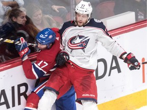 Columbus Blue Jackets forward Josh Anderson checks Canadiens defenceman Brett Kulak into the boards during NHL game at the Bell Centre in Montreal on Feb. 19, 2019.