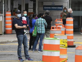 People wait in line for COVID-19 testing at the former Hôtel-Dieu hospital on Monday September 28, 2020.