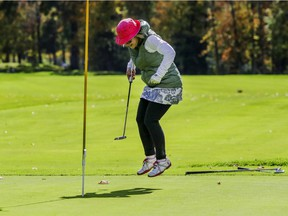 Nicole Tremblay celebrates sinking her putt on the ninth hole at Club de Golf Triangle d'Or in St-Remi, south of Montreal, on Oct. 1, 2020.