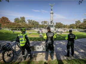 Montreal police were out in force at the foot of Mount Royal overlooking Parc Ave. on Sunday, Oct. 4, 2020.