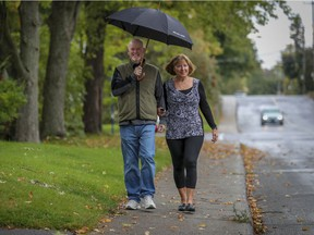 Bryan Doyle and Lucie Mauro enjoy a walk together near their home in Pointe-Claire.