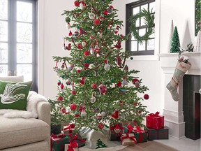 When planning your holiday decor, you should start by choosing the tree. Nine-foot balsam fir Christmas tree with 1,200 white LED Lights, $999, crateandbarrel.ca