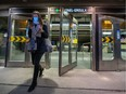 A mask-wearing commuter uses the Atwater entrance to the Lionel-Groulx Métro station on Oct. 22, 2020.