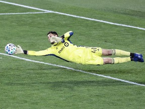 Montreal Impact goalkeeper James Pantemis makes a diving save against Inter Miami at Red Bull Arena on Saturday, Oct 17, 2020, in Harrison, N.J.