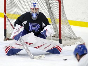 Cayden Primeau locks in on the shooter during Laval Rocket practice at the Place Bell Sports Complex in Laval, north of Montreal on Thursday January 30, 2020.