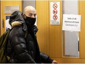 """Paul Eid, a Université du Québec a Montréal sociology professor arrives at the Montreal courthouse on Monday before testifying. He said studies he reviewed show that """"Muslims are systematically the most stigmatized"""" religious group in Quebec and the rest of Canada."""