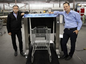 Ron Diamond, left, and his son, Hilly Diamond, of the Diamond Group display their ChemCart Disinfecting System for grocery carts.
