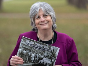 Montreal Gazette editorial page editor Edie Austin holds a copy of History Through Our Eyes in Montreal on Nov. 20, 2020. The photographs and vignettes published in 2019 have been collected in a large format book published by Véhicule Press.