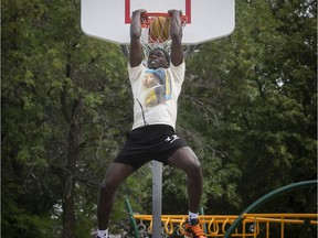 Basketball player Karim Mané dunks at a court near his home in St-Hubert on July 23, 2020.
