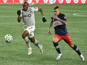 Montreal Impact defender Rod Fanni, left, and New England Revolution forward Gustavo Bou chase after the ball during the second half at Gillette Stadium in Foxborough, Mass., on Nov 20, 2020.