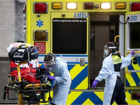 Montreal paramedics transport a senior to a COVID-19 unit in December 2020.