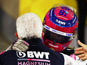 Third placed Lance Stroll of Canada and Racing Point celebrates with his father, Owner of Racing Point Lawrence Stroll in parc ferme during the F1 Grand Prix of Sakhir at Bahrain International Circuit on December 06, 2020 in Bahrain, Bahrain.