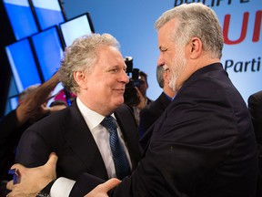 """Jean Charest, left, and Philippe Couillard are among the six former Quebec premiers who signed an open letter stating that the protection of the French language """"demands that elected officials be vigilant at all times."""""""