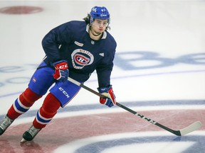 Defenceman Alexander Romanov skates across centre ice at the Bell Sports Complex in Brossard during team's first training-camp practice on Monday.