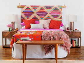 Hanging a rug as a headboard is an alternative way to reuse an area rug. Panja Rug, CB2.
