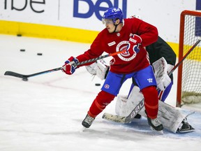 MONTREAL, QUE.: JANUARY 27, 2021 -- Brendan Gallagher tips a shot in front of Charlie Lindgren during Montreal Canadiens practice at the Bell Sports Complex in Brossard on Wednesday January 27, 2021.  (John Mahoney} / MONTREAL GAZETTE) ORG XMIT: 65667 - 7718