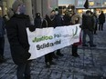 People attend commemoration vigil for the 2017 Quebec City mosque attack in Montreal on Friday, Jan. 29, 2021, during the COVID-19 pandemic.