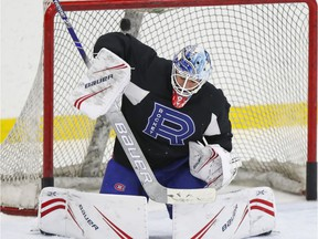 Laval Rocket goalie Michael McNiven makes a save during practice last season at Place Bell in Laval.