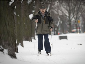 Eighty-four year-old  Georges Blanchet gets on his cross-country skis for the first time of the year, along Côte-des-Neiges Rd.