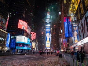The New Year's Eve ball drops in a mostly empty Times Square in New York City.