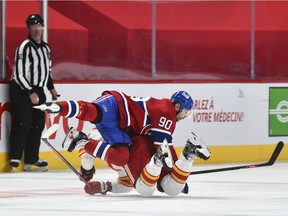 MONTREAL, QC - JANUARY 30:  Tomas Tatar #90 of the Montreal Canadiens collides with Nikita Nesterov #89 of the Calgary Flames during the third period at the Bell Centre on January 30, 2021 in Montreal, Canada.  The Calgary Flames defeated the Montreal Canadiens 2-0.
