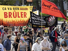 People march on René-Lévesque Blvd. in Montreal to protest against the lack of action on climate change, on Saturday, Sept. 26, 2020.
