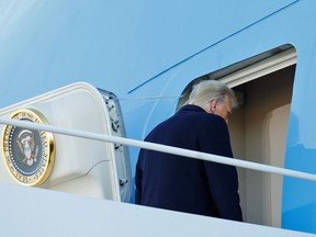U.S. President Donald Trump boards Air Force One at Joint Base Andrews, Maryland, U.S., January 20, 2021.