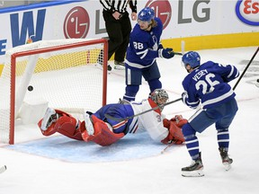 Leafs' Jimmy Vesey scores the tying goal in the third period against Canadiens goalie Carey Price Wednesday night in Toronto.