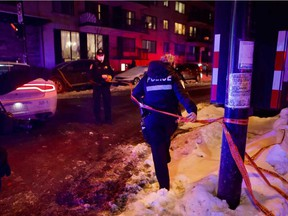 Police cordon off Anvers Ave. in Parc-Extension after an alleged altercation between a police officer and a driver a few blocks away on Thursday, Jan. 28, 2021.