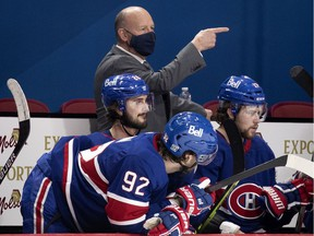 Montreal Canadiens head coach Claude Julien gives instructions from behind the bench during game against the Ottawa Senators in Montreal on Feb. 4, 2021.