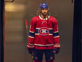 Canadiens Phillip Danault waits in a hallway outside the dressing room waiting to go onto the ice for National Hockey League game against the Toronto Maple Leafs in Montreal on Feb. 10, 2021.