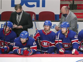 Canadiens head coach Claude Julien (right) and associate coach Kirk Muller take notes during third period of Thursday night's 3-0 loss to the Edmonton Oilers at the Bell Centre.