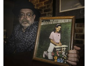 Michael Manning is seen with a photo of his daughter Tara at her first communion in this February 2019 file photo.