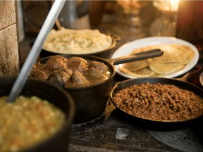 Classic Sugar Shack food warms on an antique oven at Sucrerie La Montagne in Rigaud near Montreal, on Thursday, March 14, 2019. Pea soup, meatballs, mashed potatoes, beans and pancakes.